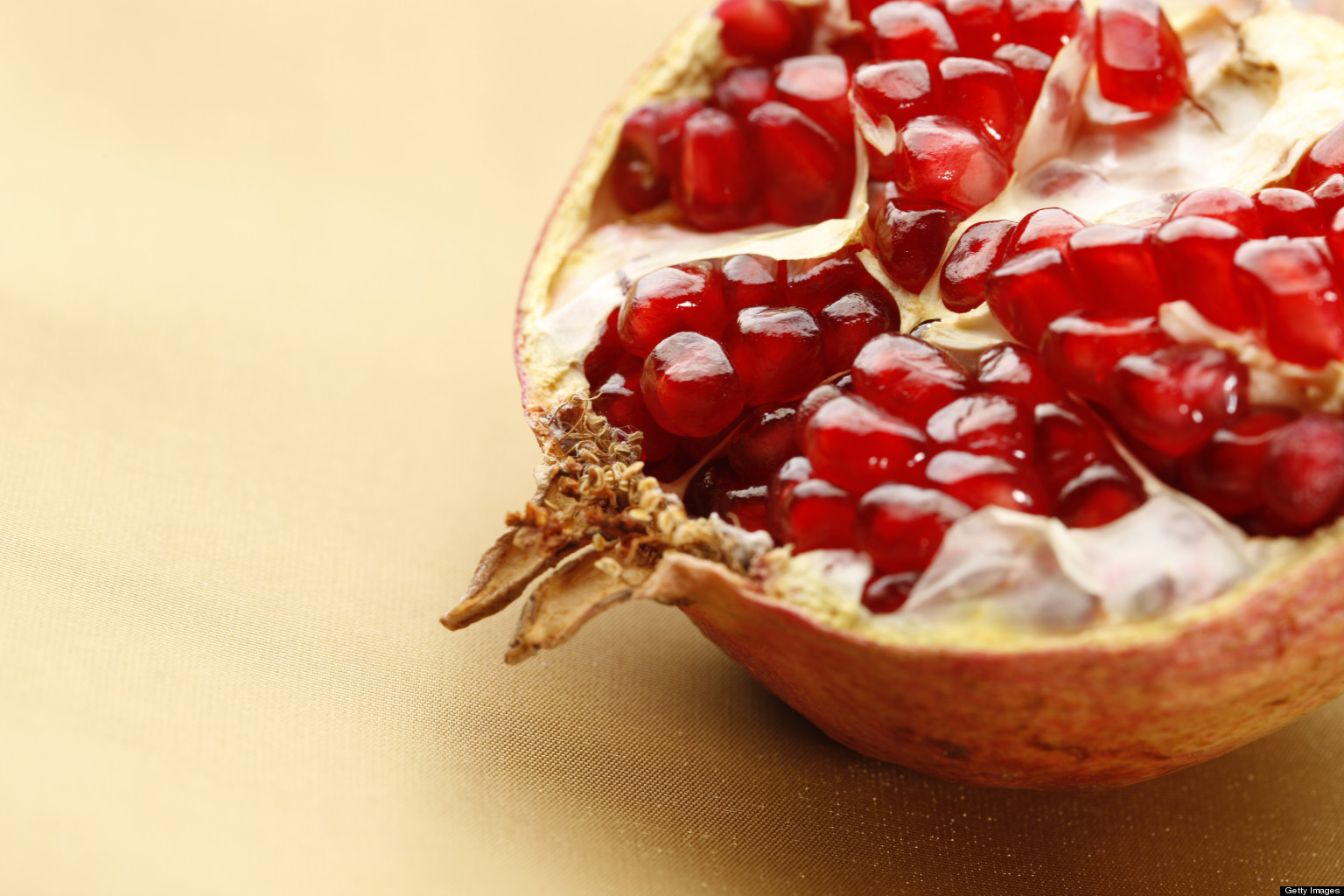 Pomegranate Fruit on Gold Background